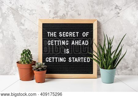 The Secret Of Getting Ahead Is Getting Started. Motivational Quote On Letter Board, Cactus, Succulen