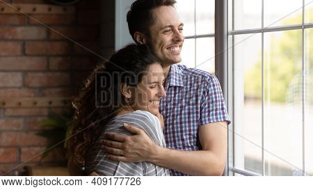 Close Up Smiling Dreamy Young Couple Hugging, Visualizing Future