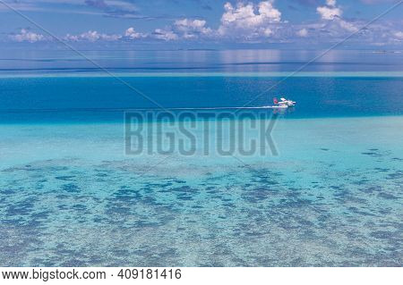 Aerial View Of A Seaplane Approaching Island In The Maldives. Amazing Nature Seascape, Coral Reef