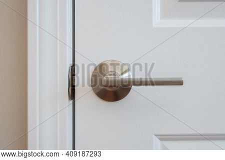 Photograph Of A Modern Styled Nickel Closet Door Lever