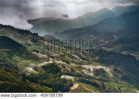 North Vietnam Rice Fields Gloomy Day With Bursts Of Light Illuminating The Vast Valley Of Rice Field