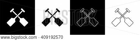 Set Paddle Icon Isolated On Black And White Background. Paddle Boat Oars. Vector