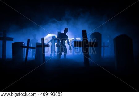 Scary View Of Zombies At Cemetery Dead Tree, Moon, Church And Spooky Cloudy Sky With Fog, Horror Hal