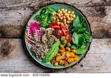 Buddha Bowl With Quinoa, Avocado, Mushrooms, Cucumber, Chickpeas, Spinach, Tomatoes, Avocado Vegetab