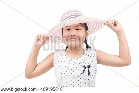 Adorable Little Girl Wearing Elegant Hat Isolated  On White Background. Have Funny Summer Holiday. S