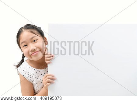 Cute Little Girl Holding A Blank Billboard Isolated On White Background, Banner And Advertising For