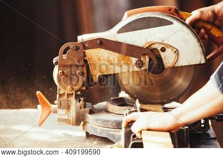 Caucasian Man Carpenter Cutting Wood With Circular Saw Creating New Furniture