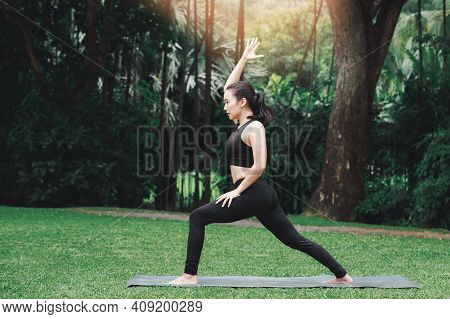 Asian Woman Practicing Yoga She To Start Preparing Of Prep Poses For Side Crane Pose For Parsva Baka