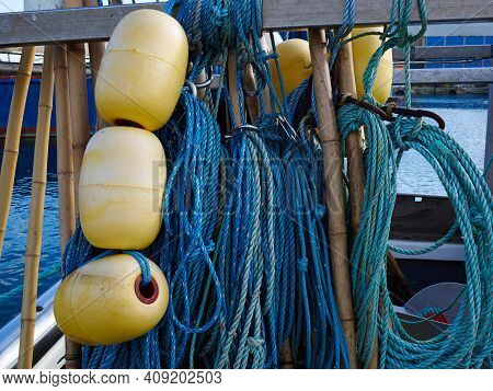 Close Up View Of Colorful Fishing Nets Hanged On A Pole In A Small Fishermen Port - Great Outdoors A