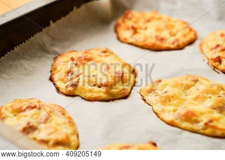 Oven Baked Tasty Gluten Free Cheese Patties With Dried Ham On Baking Tray With Baking Paper
