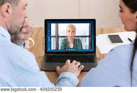 Businesswoman Discussing Working Plan With Colleagues Through Video Conference. Group Of Business Pe