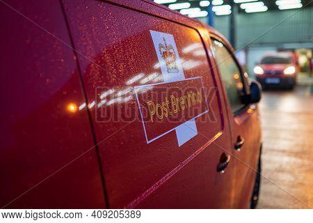 Swansea, Wales, Uk - December 12, 2020: Royal Mail Red Van With The Welsh Equivalent Post Brenhinol