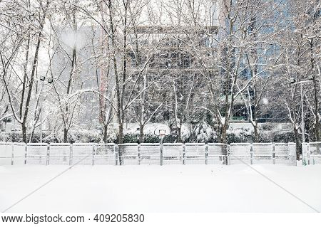Wide-angle View Of A Street Basketball Court Under The Snow During The Heavy Filomena Storm In Madri