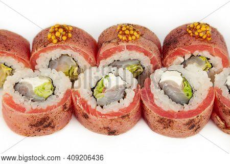 Sushi Roll With Tuna Tataki With French Mustard On A White Plate, Ingredients Seared Tuna, Sea Bass,