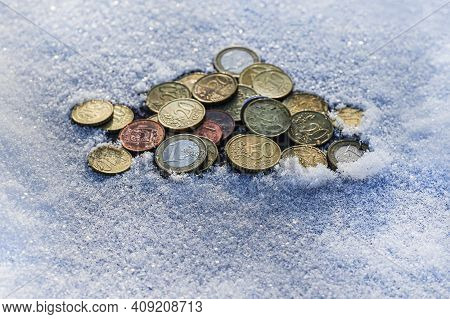 Saving Money Concept Preset By Frozen Stuck Coins In The Snow. Money Finance Coins Money Stacks Savi