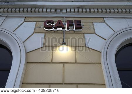 Cafe Signboard On Wall Of Building