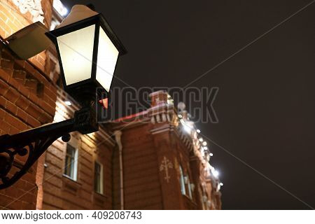Lantern On Wall Of Railway Station Building At Night