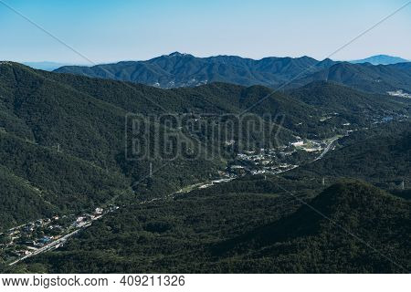 View Of The Valley With A Road And Buildings Running Through In Bukhansan National Park.