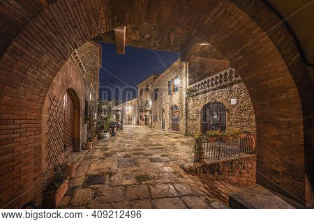 Casale Marittimo Old Village In Maremma. Picturesque Central Square, Night View. Tuscany, Italy Euro
