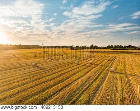 Aerial View Of Agricultural Parcels Of Different Crops. Hay Bale Fields And Farmlands Of Lithuania.