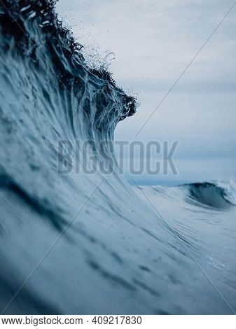 Perfect Ocean Waves With Blue Water Cloudy Sky.