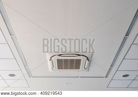 The Air Conditioner Is Installed On The Ceiling In The White Room With The Lamps. Air Conditioning I