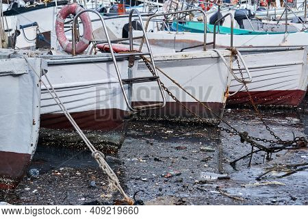 Environmental Pollution - Extremely Dirty Water Between Moored Ships In The Harbor