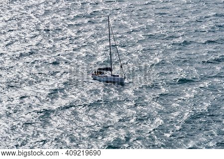 Sevastopol, Crimea - February 02, 2021: The Yacht Lowered The Sail And Is Moving Under The Engine In