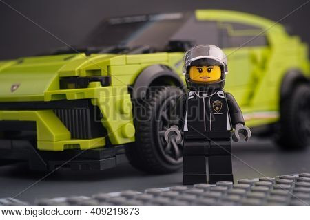 Tambov, Russian Federation - February 14, 2021 Lego Lamborghini Driver Minifigure Standing Near Her