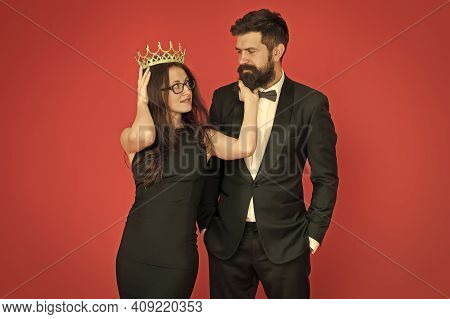 Falling In Love With Boss. Couple In Love Red Background. Beauty Queen And Bearded Man. Egoistic Lov