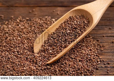 Lots Of Dry Anise Seeds. Anise Seeds In A Wooden Spoon. Spice.