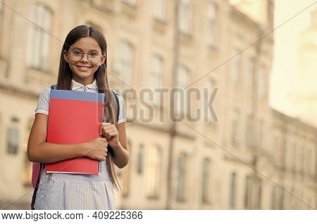 To Succeed You Must Read. Happy Child Hold Books. School Library. Library Reader Smile Outdoors. Rea