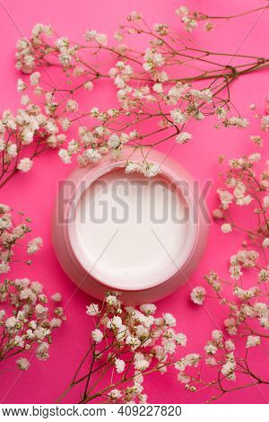 Cream For Face In Flowers . Face Cream On A Pink Background. Skin Care. The Beauty Industry. Copy Sp