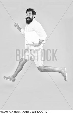 Get Your Freelance Business Up And Running. Bearded Man In Midair. Energetic Freelancer Yellow Backg