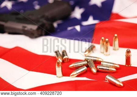 Many Yellow 9mm Bullets And Gun On United States Flag. Concept Of Gun Trafficking On Usa Territory O