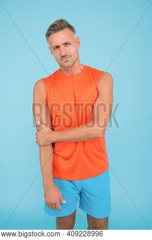 Shape Your Future. Muscular Type. Muscular Guy Blue Background. Fit Man With Strong Arms. Sportsman