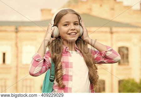 Educational Podcast. Kid Girl Enjoy Music. Pleasant Time. Child Headphones Listen Music. Audio Book