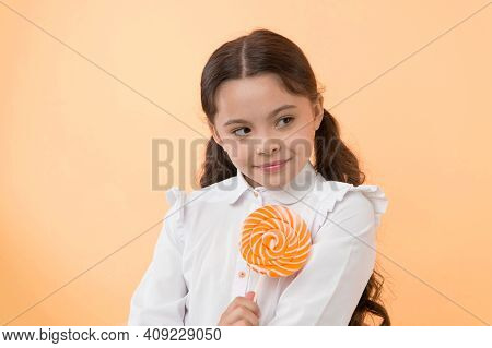 Girl Happy Face Holds Sweet Lollipop Ok Gesture. She Deserved Candy. Girl Likes Sweet Candy Yellow B