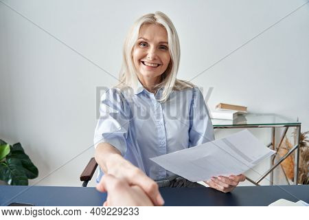 Smiling Middle Aged Female Company Hr Manager, Employer Holding Cv Shaking Hand Hiring New Employee
