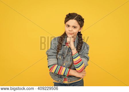 Small But Smart. Small Girl With Thoughtful Look. Small Child Wear Long Braided Hairstyle. Adorable