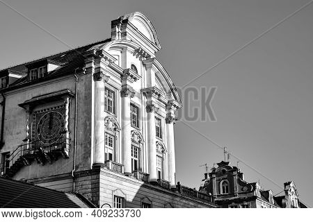 The Facade Of A Historic Tenement House With A Clock In Poznan, Monochrome