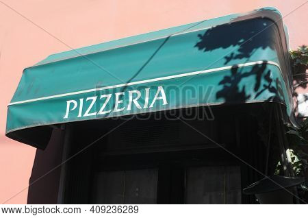 Pizzeria Logo In Summer Time In The City