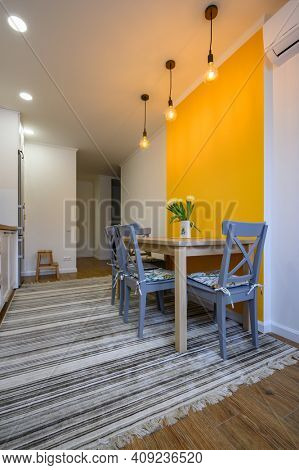 small dining table in cozy well designed dining room