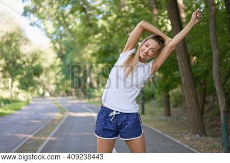Woman Runner Stretching Arms Before Exercising Summer Park Morning Middle Age Athletic Female Warmin