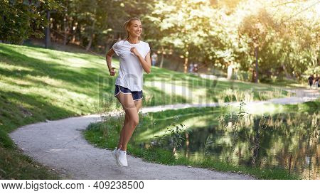 Woman Running Road Summer Park Near Lake Active Sporty Caucasian Female Morning Workout Healthy Life