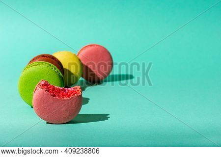 Small Colored Macaroon Cookies In Daylight. Bitten Macaroon