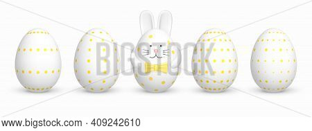 Set Of Painted White Easter Eggs In A Dotted Pattern With Easter Egg In The Shape Of A Rabbit. Easte