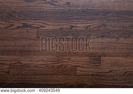 Photograph Of Hardwood Flooring With A Walnut Stain