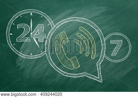 Phone Icon With Lettering 24-7 Drawn In Chalk On A Green Chalkboard. Contact Center, Call Center, Se