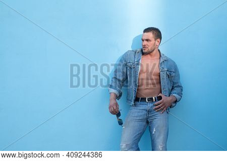 Jeanse Fashion. Handsome Man Bare Torso. Naked Male Body. Sexy Muscular Man. Nude Abs